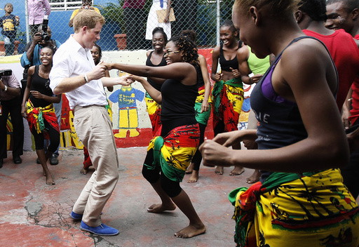 Britain's Prince Harry dances with Dormer at a youth community center in Kingston