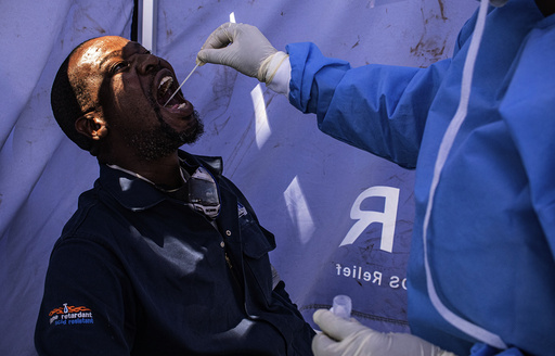 A motorist is tested for COVID-19 at a mobile testing station on an inter-provincial highway at the Grassmere Toll Plaza near Johannesburg Tuesday, Jan. 19, 2021. (AP Photo/Ali Greeff)