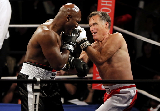 Former Massachusetts Governor and two-time presidential candidate Mitt Romney fights five-time heavyweight champion Evander Holyfield during their boxing match in Salt Lake City, Utah