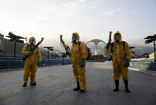 Municipal workers wait before spraying insecticide at Sambodrome in Rio de Janeiro