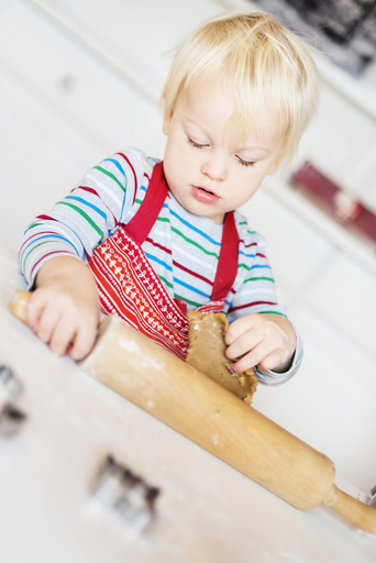 Boy making cookies at home