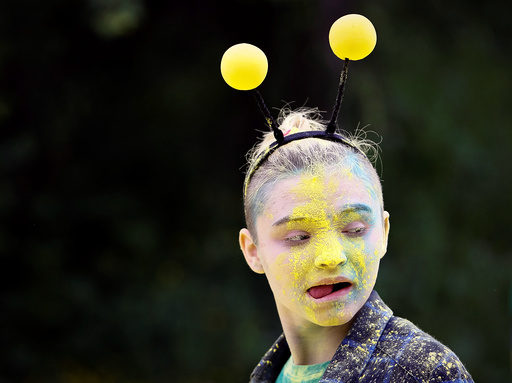 A volunteer reacts during the YARKOcross colour run race in Almaty