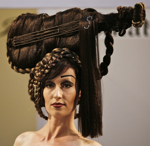 Model presents a creation during a hair show in Budapest