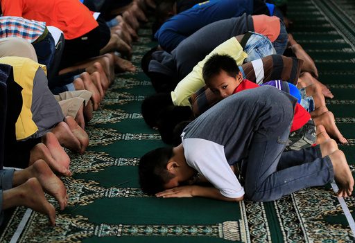 Muslims pray inside a mosque during their noon prayer a few days after President Rodrigo Duterte announced the liberation of their town from pro-Islamic State militant groups in Marawi city