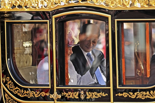 Britain's Queen Elizabeth and the President of China Xi Jinping are driven by carriage along The Mall to Buckingham Palace in London