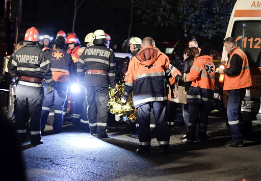 Emergency services work outside a nightclub in Bucharest