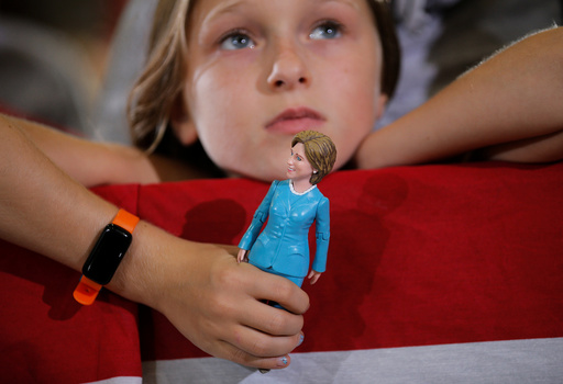 Nine-year-old Belle Shefrin holds a doll of U.S. Democratic presidential nominee Hillary Clinton while listening to Clinton speak at a campaign rally in Akron