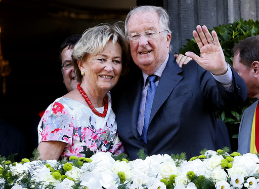 Belgium's King Albert II and Queen Paola wave from the balcony of the city hall during a visit in Liege