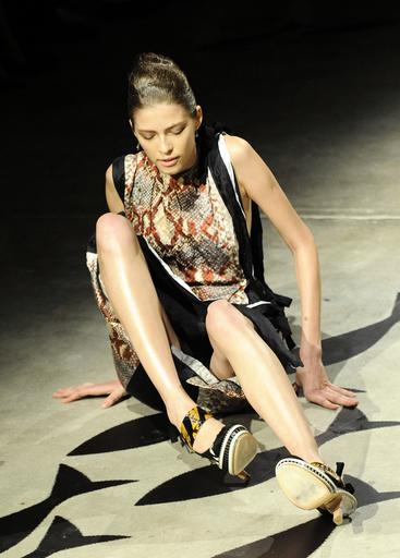 A model falls during Prada's Spring/Summer 2009 women's collection at Milan Fashion Week