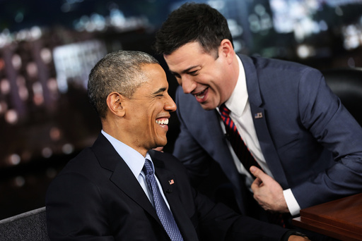 Obama laughs with show host Jimmy Kimmel during a commercial break in a taping of Jimmy Kimmel Live in Los Angeles