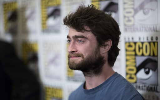 Cast member Radcliffe poses at a press line for