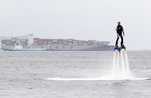 A participant performs during a local cultural and sports festival in Vladivostok