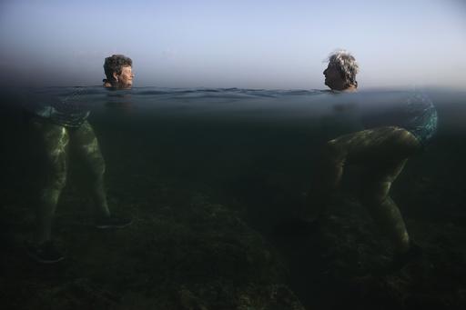 People swim at the sea in Havana