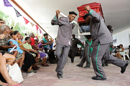 Surinamese pallbearers compete in a song and dance contest in Paramaribo