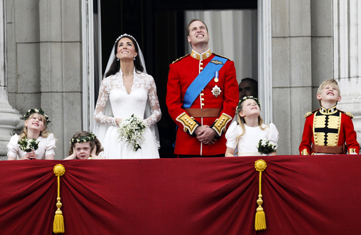 Britain's Prince William and his wife Catherine, Duchess of Cambridge, watch the fly past as they stand on the balcony at Buckingham Palace after their wedding in Westminster Abbey, in central London
