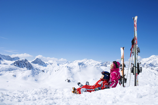 A mother and her sun resting on the slopes.