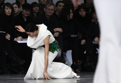A model falls as she presents a creation by French designer Rolland as part of his Haute Couture Spring-Summer 2013 fashion show in Paris