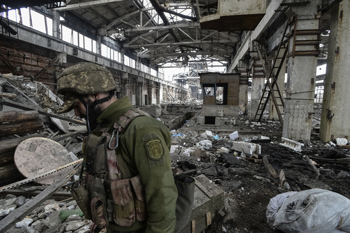 Ukrainian serviceman guards an area on front line at industrial zone of Avdiyivka