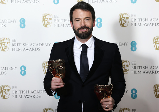 Affleck celebrates after winning the Awards for Best Film and Best Director at British Academy of Film and Arts awards ceremony in London