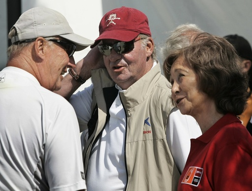 Spain's King Juan Carlos and Queen Sofia talk with Norway's King Harald after arriving at Golondrinas dock during fifth stage of 26th King's Cup Race in Palma de Mallorca