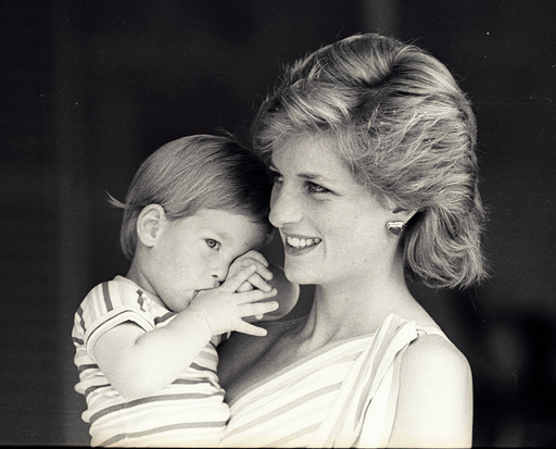 Young Prince Harry tries to hide behind his mother Diana, Princess of Wales