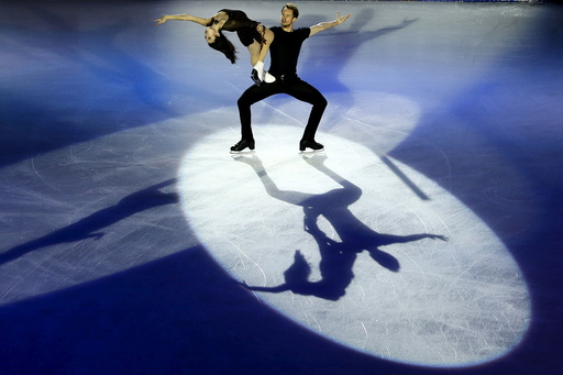Madison Chock and Evan Bates of the U.S perform at an exhibition event for China ISU Grand Prix of Figure Skating in Beijing