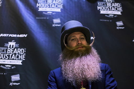 Winner, Scott Metts from Orlando, Florida, poses for a photograph at the 2015 Just For Men National Beard & Moustache Championships at the Kings Theater in the Brooklyn borough of New York