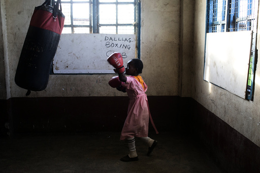 A girl practices boxing at a local gym for disadvantaged youth in Kamukunnji