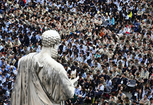 The statue of Saint Peter overlooks the faithful as they attend a mass for the Youth Jubilee led by Pope Francis in Saint Peter's Square at the Vatican