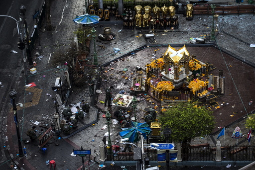 Experts investigate the Erawan shrine at the site of a deadly blast in central Bangkok