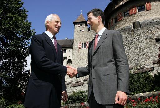 Prince Hans-Adam of Liechtenstein II (L) and his son Crown Prince Alois of Liechtenstein shake hands