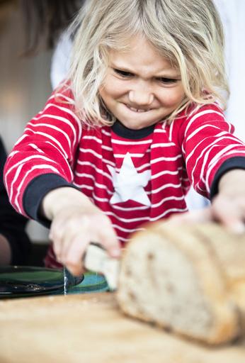 Girl slicing bread