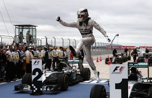 Mercedes Formula One driver Lewis Hamilton of Britain leaps off of his car after winning the U.S. F1 Grand Prix at the Circuit of The Americas in Austin