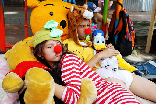 People dressed in pajamas while participating in an event marking the World Day of laziness Itagui