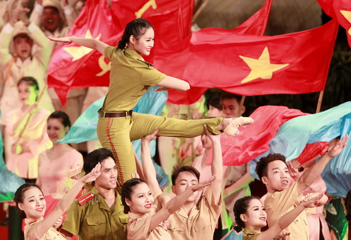 People perform during celebrations to commemorate 70th anniversary of establishment of Vietnam Public Security police force at National Convention Center in Hanoi
