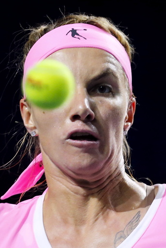 Kuznetsova of Russia looks at ball during her Kremlin Cup semifinal tennis match against Tsurenko of Ukraine in Moscow