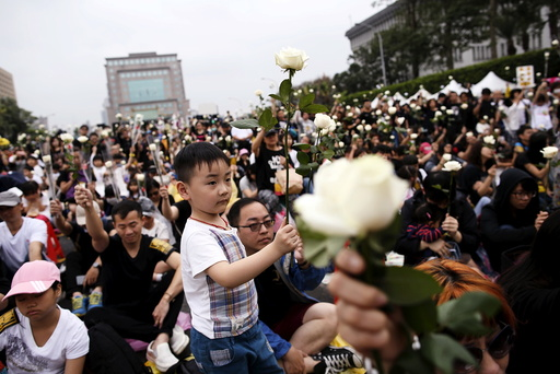 Supporters of the death penalty display white roses during a rally in front of Presidential Office in Taipei