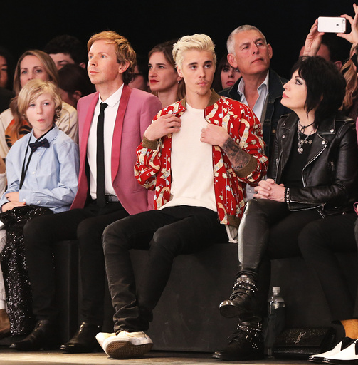 Musicians Beck, Bieber and Jett watch the Saint Laurent fall collection during a fashion show at the Hollywood Palladium in Los Angeles