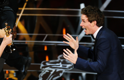 Actor Redmayne reacts as he takes the stage to accept the Oscar for best actor for his role in