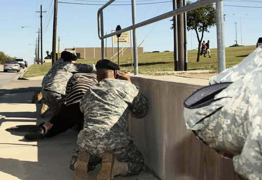 Bystanders crouch for cover as shots rang out from Fort Hood's Soldier Readiness Processing Center