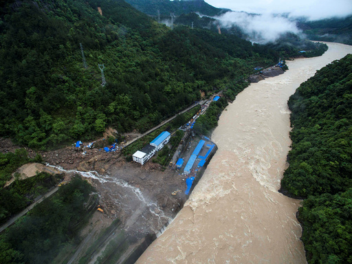 An aerial view shows buildings at a hydroelectric power station under construction are hit by landslide in Sanming
