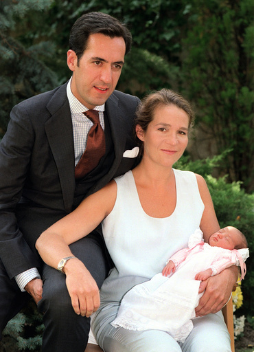SPAIN'S INFANTA ELENA AND HER HUSBAND POSE WITH THEIR NEWBORN DAUGHTER