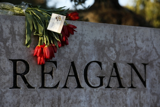 Flowers are placed on a sign at The Ronald Reagan Presidential Library in honor of former First Lady Nancy Reagan, who died at the age of 94, in Simi Valley, California