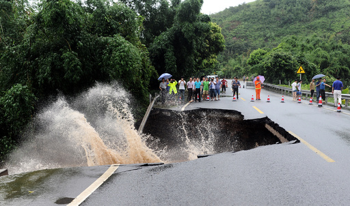 A road is seen damaged by heavy rainfall as Typhoon Nepartak lands in Fuzhou