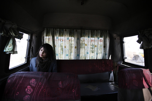 A woman rides a women-only bus as she returns from her college in Kathmandu