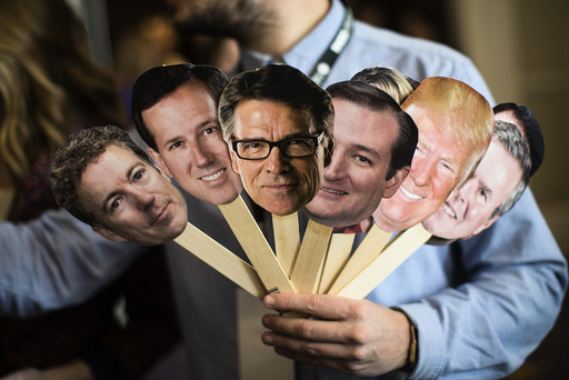 A man interviewing attendees holds photo cutouts of 2016 presidential hopefuls at the Conservative Political Action Conference.
