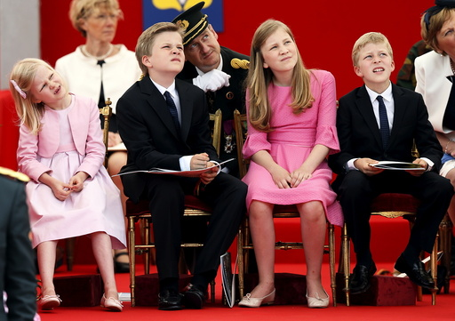 Belgium's Princess Eleonore, Prince Gabriel, Crown Princess Elisabeth and Prince Emmanuel watch the traditional military parade in front of the Royal Palace in Brussels