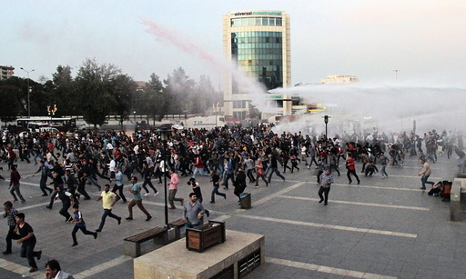 Police in Diyarbakir, Turkey, use tear gas and water cannon to disperse people marching to protest the double suicide bombing in Ankara that killed up to 128 people