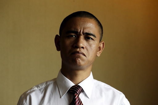 Xiao Jiguo, a 29-year-old actor from China's Sichuan province, impersonates U.S. President Barack Obama, in a hotel room in the southern Chinese city of Guangzhou