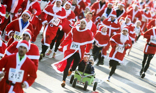 Runners dressed as Father Christmas participate in the Nikolaus Lauf (Santa Claus Run) in the east German town of Michendorf, southwest of Berlin